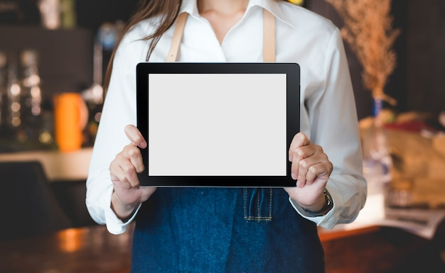 Close up on blank tablet computer that barista show and holding with two hand