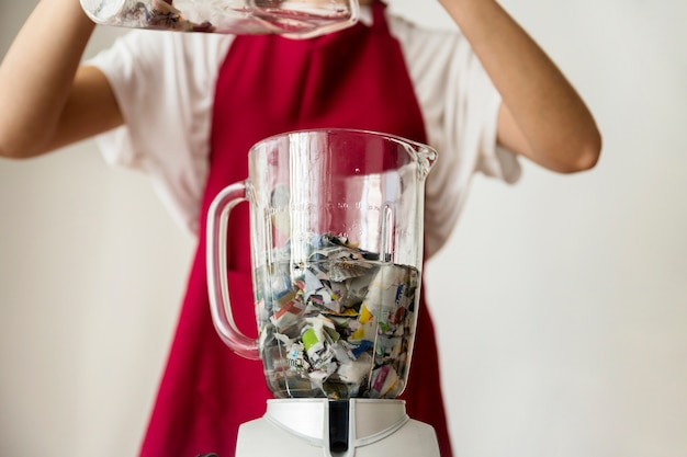 Close-up of a blender filled with water and paper pieces