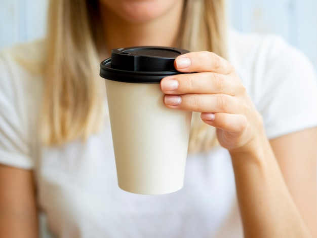 Close-up blonde woman with coffee cup