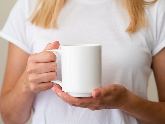 Close-up blonde woman with mug