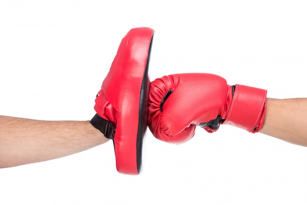 Close-up blow of a male boxer in boxing gloves.