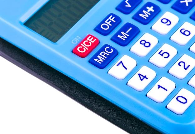 仕事のオフィス、選択的な焦点で青いビジネスデザイン計算機を閉じます。