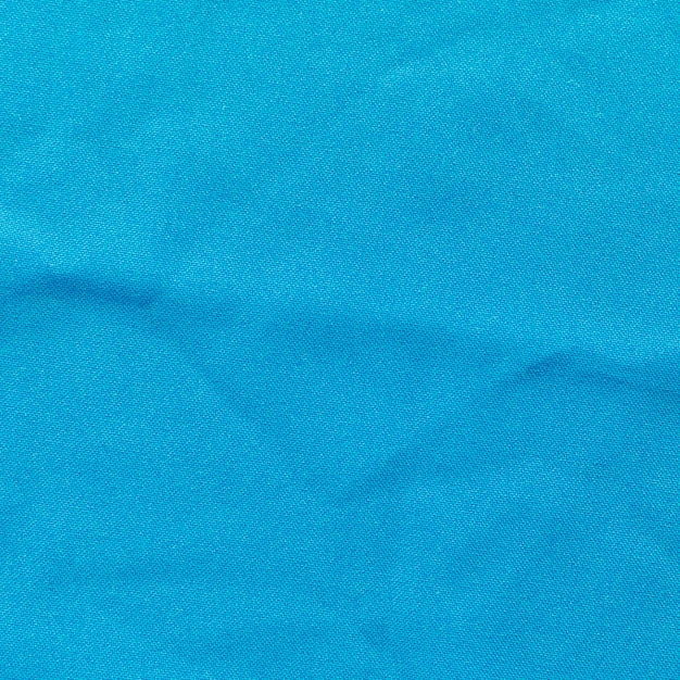 Close-up of blue cloth textured background