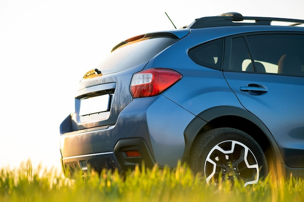 Close up of blue off road car on green grass. traveling by auto, adventure in wildlife,