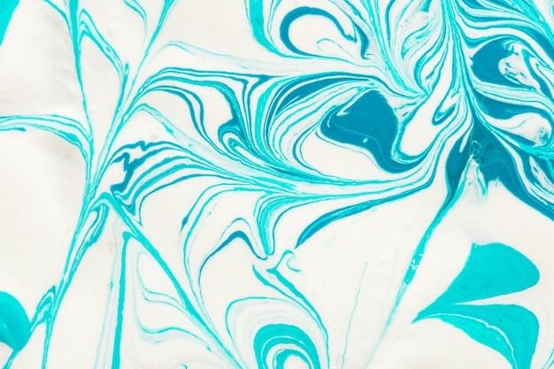 Close-up of blue paint swirls