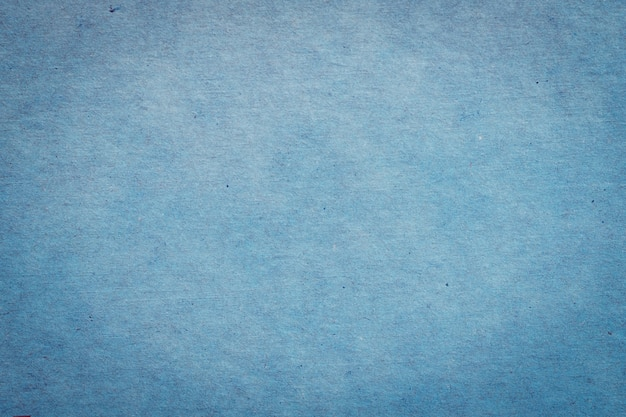 Close up blue paper texture and background with space.