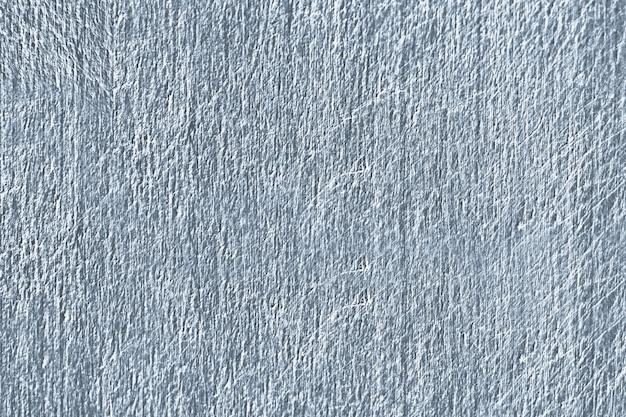 Close up of a blue scratched concrete wall texture