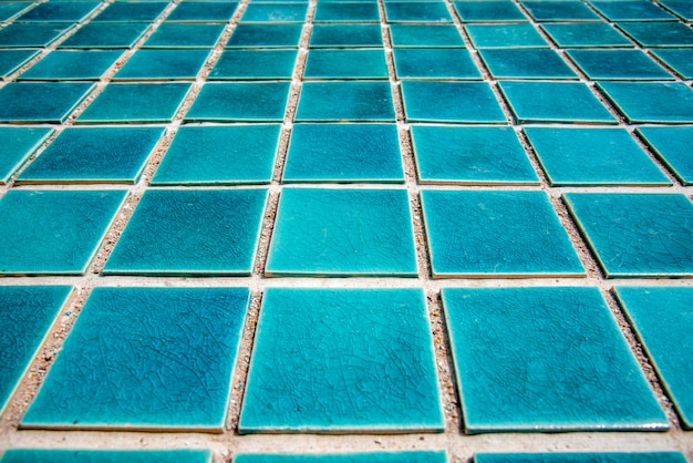Close up of blue swimming pool tiled floor. architect and construction