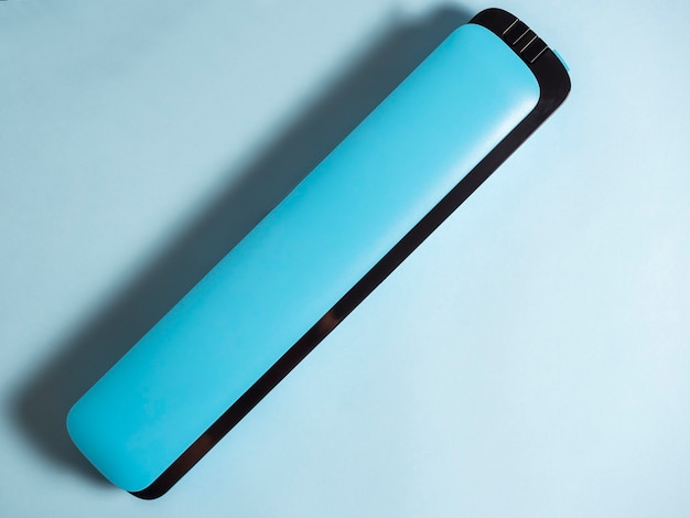 Close-up of a blue vacuum packer isolated on a bright blue background. machine to preserve the freshness of the products. flat lay, top view.