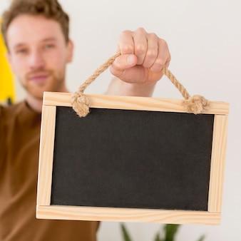 Close-up blurred man holding frame