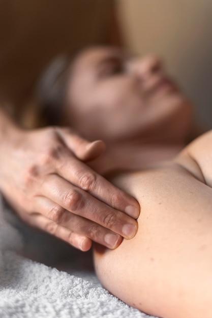 Close-up blurry woman at massage