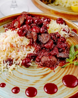 Close up boiled rice with meat and cherries
