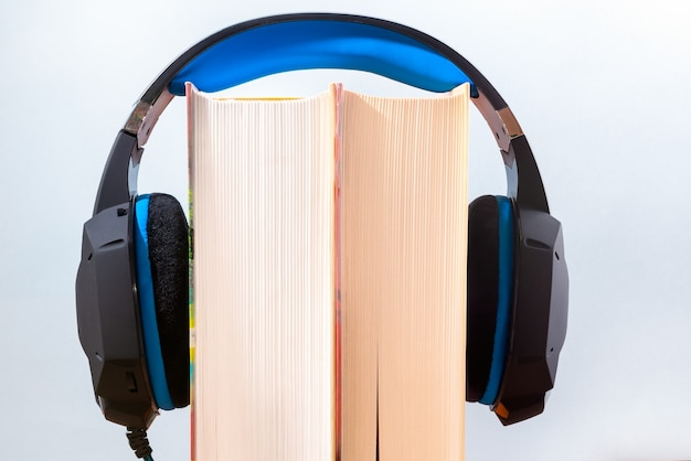 Close up of books and modern headphones