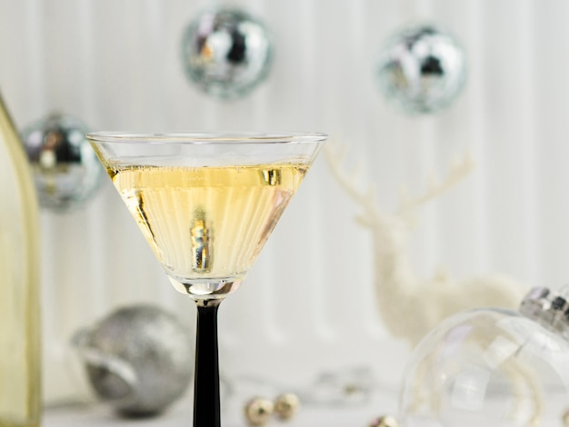 Close-up of bottle of champagne with silver globes