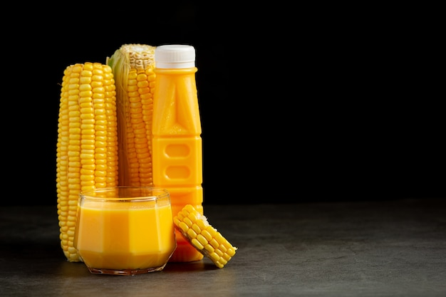 Close up on bottle of corn juice ready to eat