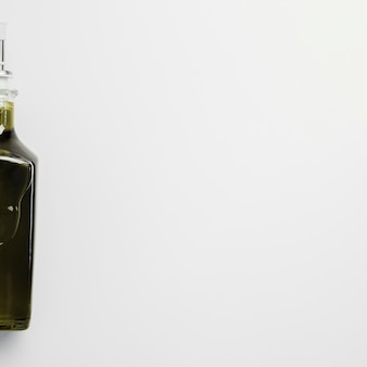 Close-up bottle of olive oil with copy space