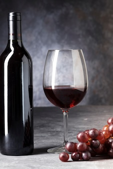 Close-up bottle of red wine and glass