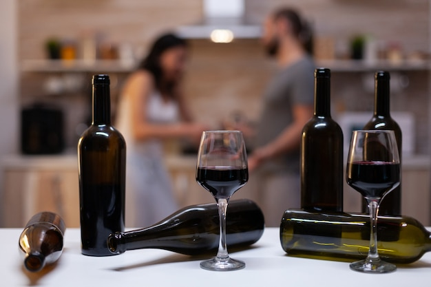 Close up of bottles and glasses filled with wine