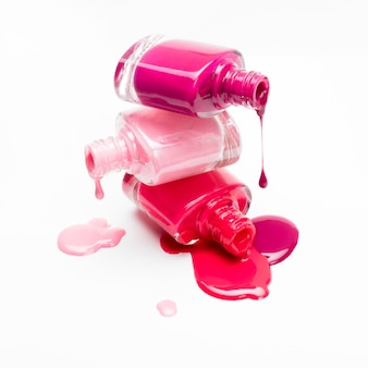 Close-up of bottles with spilled nail polish