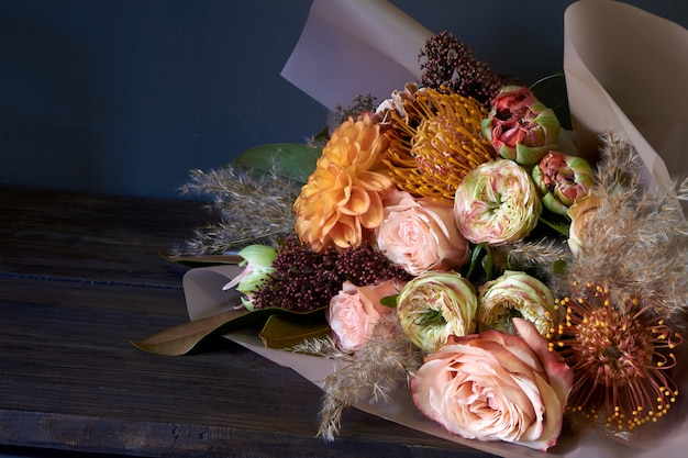 Close-up bouquet decorated in vintage style on a dark background, selective focus