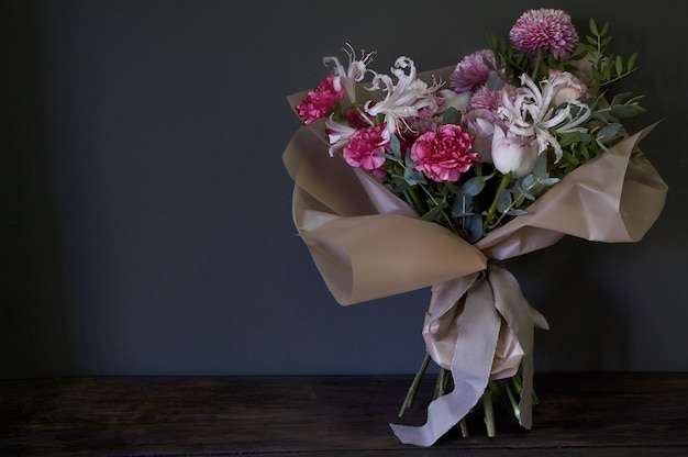 Close-up of bouquet decorated in vintage style on a dark background