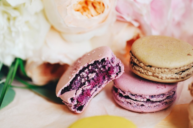 Close-up of a bouquet of delicate flowers and macaroons