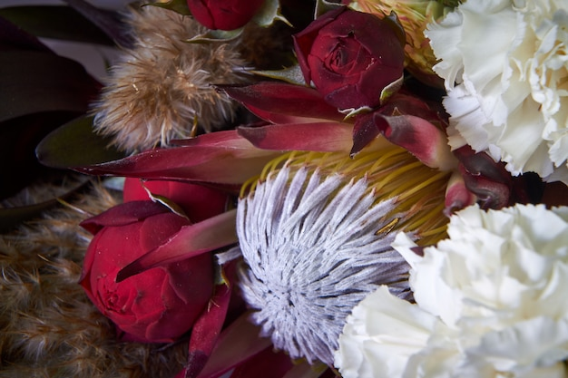 Close-up of bouquet details decorated in vintage style on a dark background