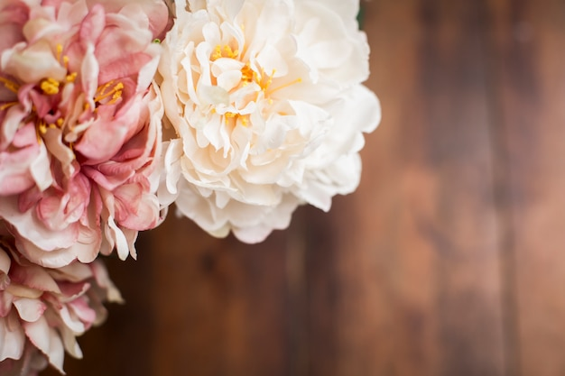 Close up of a bouquet of flowers on wooden table vintage style