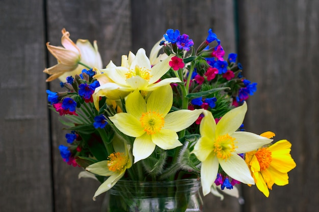 Close up bouquet of wildflowers on a wood
