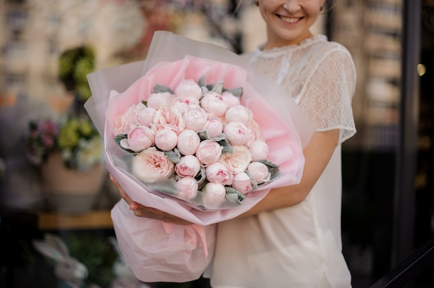 Close-up of a bouquet with pink peonies
