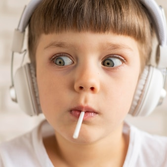 Close-up boy listening music
