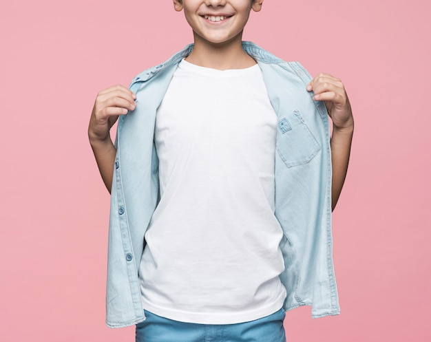 Close-up boy showing shirt
