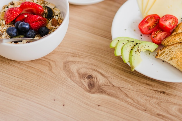 Close-up of breakfast plates on wooden table