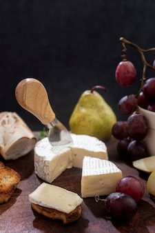 Close-up brie cheese with grapes