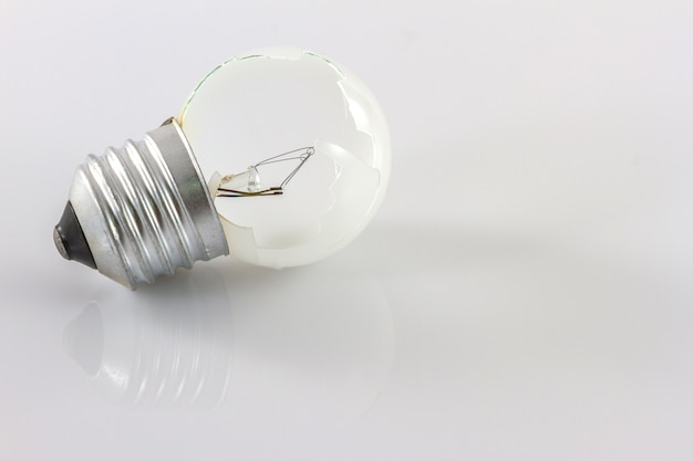 Close up broken bulb isolate on white background