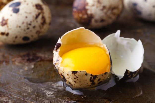 Close up broken eggs with yellow yolk