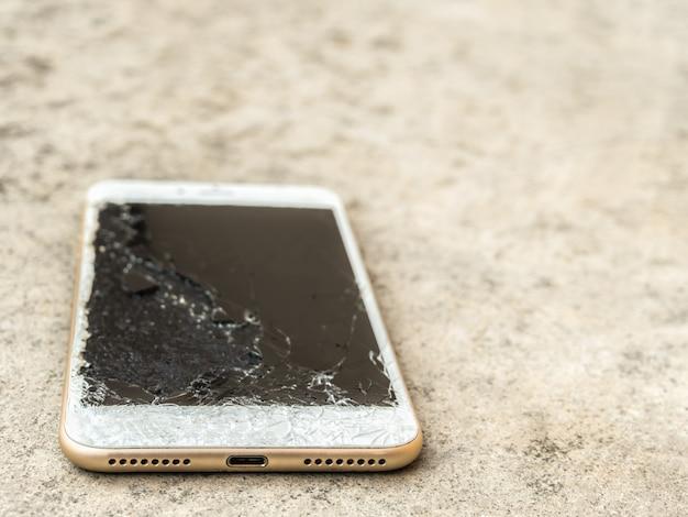 Close up of broken mobile phone drop