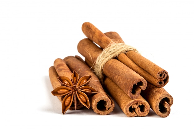 Close up the brown cinnamon stick with star anise spice isolated on white