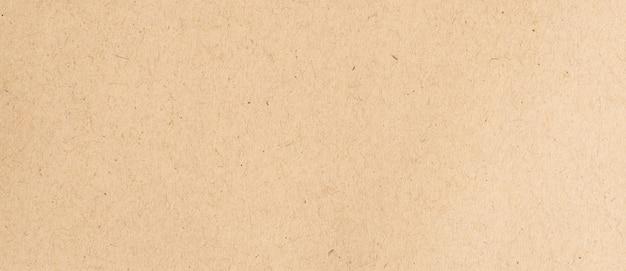コピースペースで茶色の紙のテクスチャと背景をクローズアップ