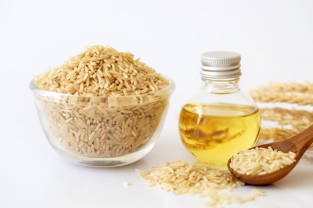 Close up brown rice seed and rice bran oil in bottle