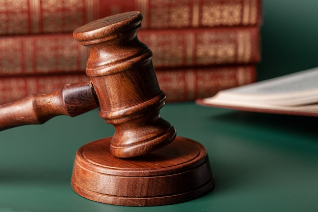 Close up of a brown wooden gavel and book