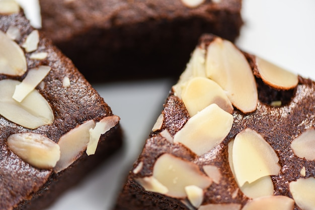 Close up brownies cake slice with nut on plate