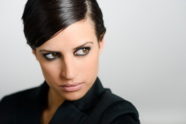 Close-up of brunette woman with intense look