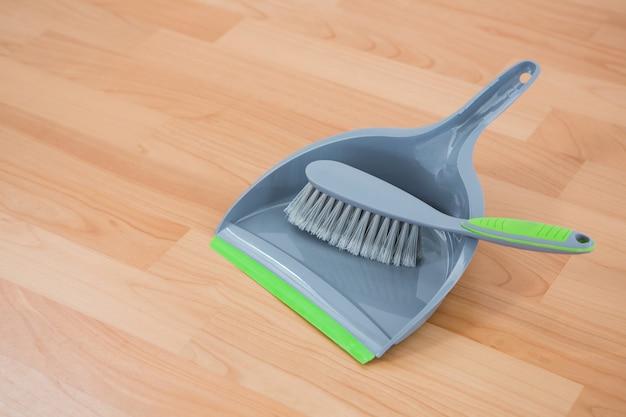 Close up of brush on dustpan