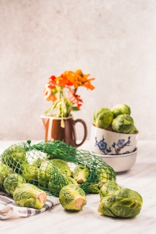 Close-up of brussels sprouts on marble tabletop