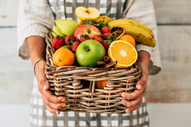 Close up of bucket full of fresh seasonal coloured fruits for healthy lifestyle and diet nutrition plan