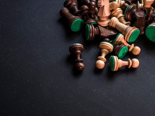 Close up bunch of classic traditional chess figures on black surface