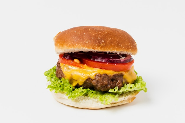 Close-up of burger on white table
