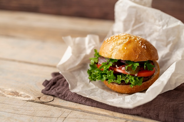 Close-up burger with wooden background