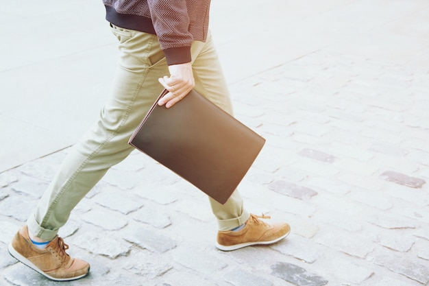 Close up business man in casual wear hand holding briefcase